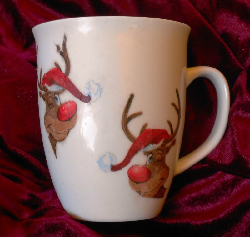cute cup with funny reindeer with red nose